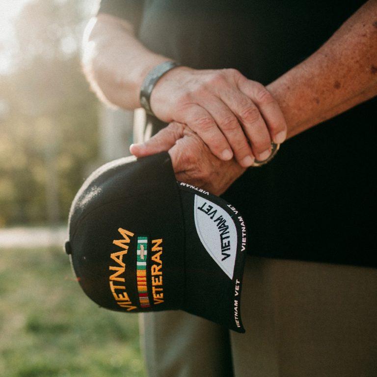 Hands holding a Vietnam veteran hat